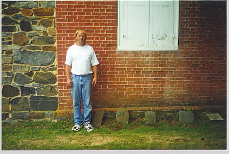 Randy standing near Job Tombstones