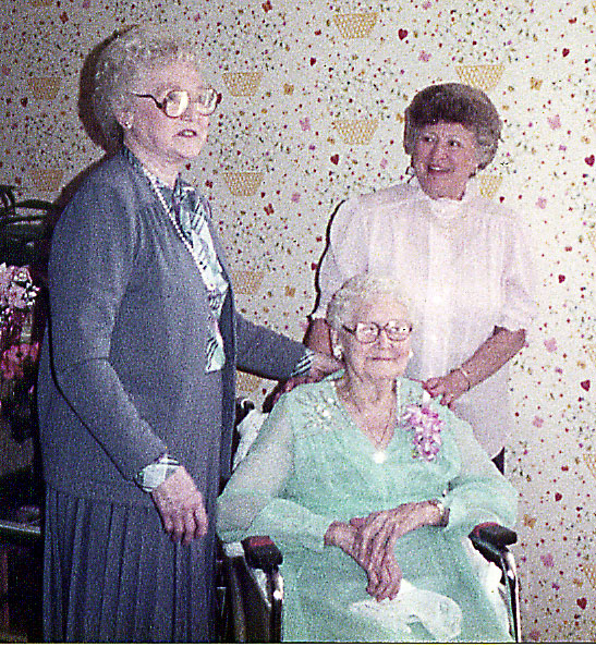 Aunt Ethel at her 100th birthday party; with a daughter and granddaughter. Identity Pending..