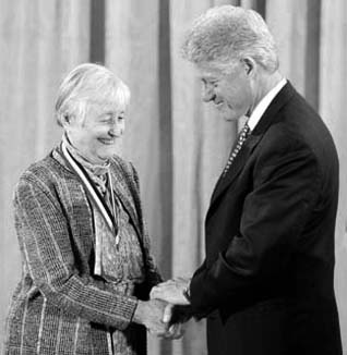 Cathleen (nee Synge) Morawetz - Receiving an award from President Clinton