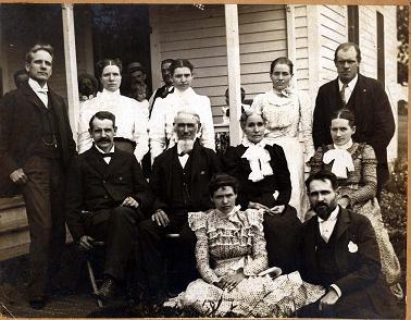 Standing: Darius, Elizabeth, Belle, Sadie, Charles Seated: Hector, Robert, Jane, Anna  Front: Martha, Dan